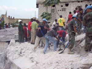Fr. Rick and emergency response teams attempting to dig children out of the collapsed school.