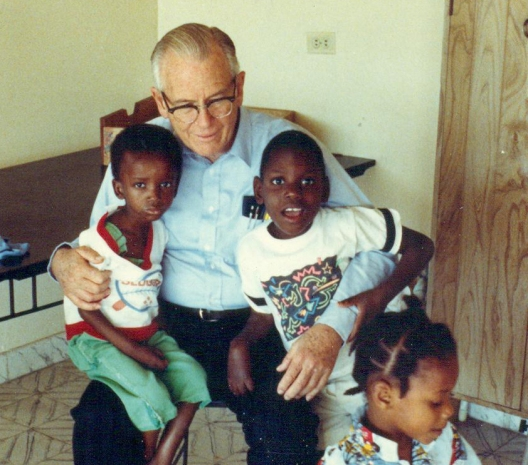Fr. William Wasson with children at St. Damien Hospital